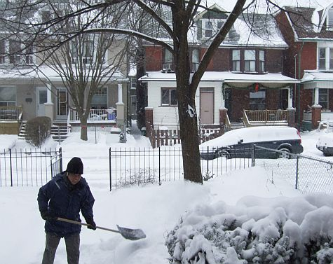 Shovelling snow out the front yard